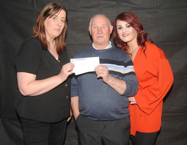 Rosie and Elaine Furlong from the Ash Tree, Ballywilliam, presenting a cheque for €2,600 to Stephen Walsh of New Ross River Search and Rescue