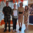 Emma McDonald with her Defence Forces Challenge cert, joined by Lieutenant Ian Galloway, Gaisce CEO Yvonne McKenna and Ultimate Hell Week's Grace O'Rourke