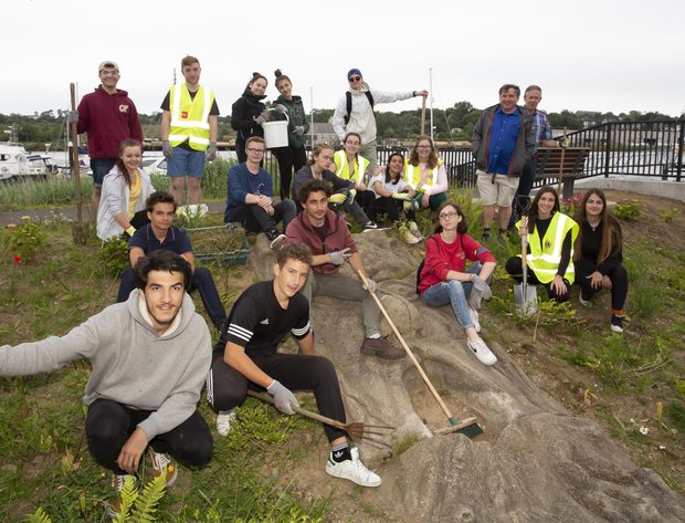 Lions club exchange students help clean up the River God at New Ross marina