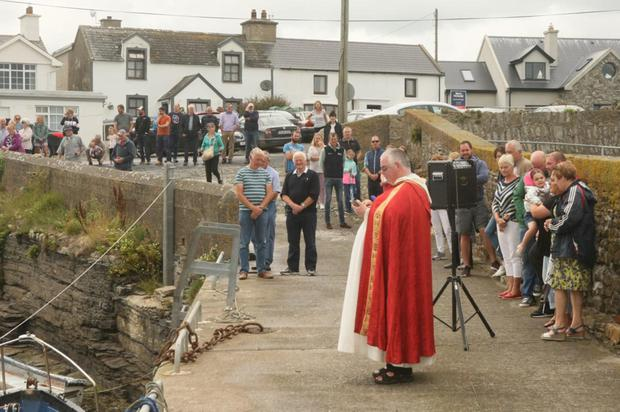 Rev Michael Doyle, Templetown, blessing the boats at Slade Harbour.