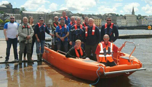 Members of New Ross River Search and Rescue on their new lifeboat.