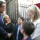 An Taoiseach Leo Varadkar shaking hands with Seamus Whelan, son of the late Noel Whelan. Also pictured is Noel's wife Sinead McSweeney (on the right). Photo: Mary Browne