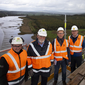 Engineer Joe Hennessy, engineer Larry Mackey, David Looby and Sean Dobbs, project liaison officer, on the bridge