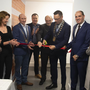 Cllr Michael Sheehan, chairperson Wexford County Council cuts the ribbon to mark the official reopening of Newbawn Hall