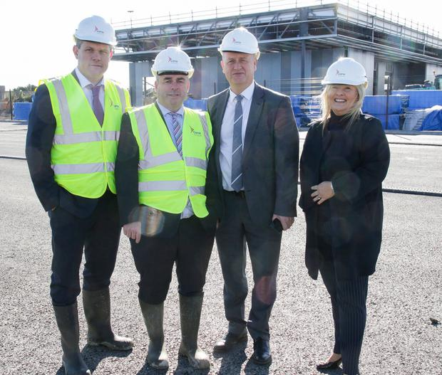 Cllr Ger Carthy, Kevin 'Boxer' Moran TD, Minister of State, Tom Enright (CE Wexford County Council) and Verona Murphy at the site in Rosslare Harbour