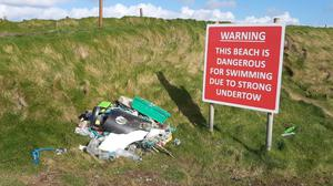 Beach walkers are leaving washed up rubbish they find at Carnivan beach at the top of the slipway for collection