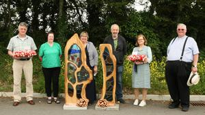 Fergal Murphy, Orla Doyle, Domini Codd, sculptor David Kennedy, Katie Moran and Fr. Michael Doyle at the event to mark Fergal and Katie's retirement from Scoil Mhaodhóig Poulfur.