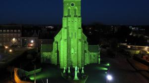 St James's Church lit up in green by the community for St Patrick's Day. Photo: Nichola Browne Sinnott