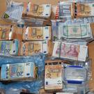 €135,000 in various currencies was recovered during the house search