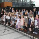 Bernie Murray Ryan and Roisin Quigley leading the Raheen N.S. choir in song at the Dunbrody Visitor Centre