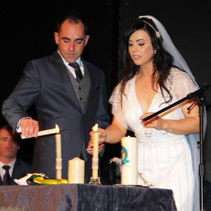 Allen O'Donnell and Anita Doran light their wedding candle
