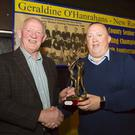 Special guest Tony Doran receiving a presentation from club chairman Fintan Walsh