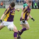 Wexford's Aaron Dobbs has a shot at goal during the Leinster Minor football championship