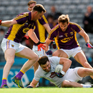 Fergal Conway of Kildare in action against Daithí Waters, left, and Brian Malone of Wexford in the Leinster GAA Football Senior Championship