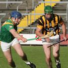 Conor Kenny of Buffers Alley competes with Eoin Doyle of Shelmaliers