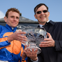 Jockey Ryan Moore and trainer Aidan O'Brien celebrate with the trophy after winning the Comer Group International Irish St Leger on Order of St George during the Longines Irish Champions Weekend 2017 at The Curragh Racecourse in Co Kildare last weekend