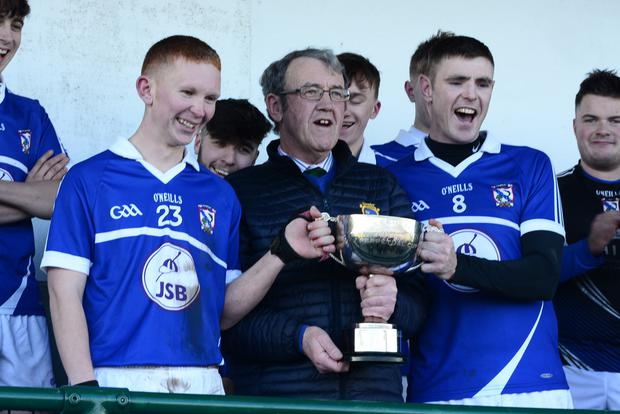The All-Ireland Junior 'B' cup is handed over to Oylegate-Glenbrien's joint captains Marty Kelly and Brian Doran