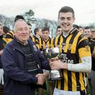 Noel O'Keeffe presented the cup to Craig McCabe