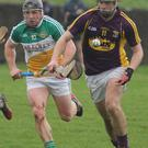 Aidan Nolan on the move as Offaly's Seán Ryan gives chase