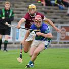 Barry O'Connor of St Martin's challenges Shane Codd