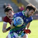 Glynn-Barntown wing-back Nigel Usher is tackled by Rory O'Connor of St. Martin's