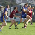 Cillian Kehoe of Gusserane attempts to break away from Castletown duo Richard Farrell and Anthony Masterson