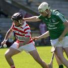Ryan Nolan (Ferns) battles for the ball with Gorey's Eoin Molloy