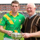 Buffers Alley captain Ciarán Kenny with club legend Tony Doran