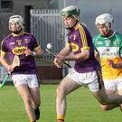 Gary Molloy bursts upfield out of reach of Offaly attacker Conor Freeman