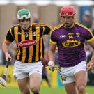 Man of the match Lee Chin surges away from Kilkenny captain Paddy Deegan