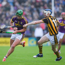 Conor McDonald taking on T.J. Reid during that memorable win against Kilkenny.