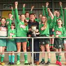 The Clonroche girls celebrate after receiving the trophy from Jim Dempsey of the Rackard League.