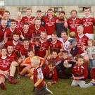 The Castletown squad celebrate after their victory over Gusserane in Bellefield on Friday