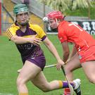 Joanne Dillon about to gather the ball after evading Chloe Sigerson of Cork