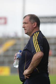 A deflated Seamus McEnaney watching the one-sided action unfold