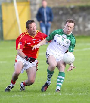 St. James' marksman Kevin O'Grady is challenged by David Larkin