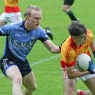 Dylan Furlong of Sarsfields shields the ball from St. Anne's defender Diarmuid O'Keeffe