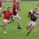 Conor Carty gathers possession for Castletown as Ricky Fox (Starlights) gives chase