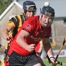 Peter Murphy of Oulart-The Ballagh follows the flight of the ball with Aidan Cash (Shelmaliers) hot on his heels