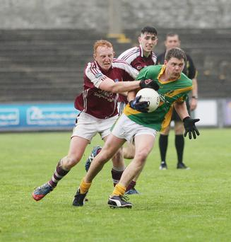 Brian O'Neill is challenged by Seán Stafford of St. Martin's