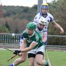 Cloughbawn captain Robert Kinsella under pressure from Craanford duo Eoin and Martin Doyle