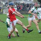 Paul Roche of Crossabeg-Ballymurn attempts to hook Diarmuid Fenlon (Monageer-Boolavogue) while Padraig Foley looks on