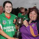 Leah Walsh receives the cup from Kathleen Kehoe (Co. Secretary).