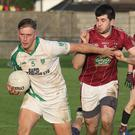 Conor Devereux of Crossabeg-Ballymurn brushes Multyfarnham's Brian McLoughlin aside.