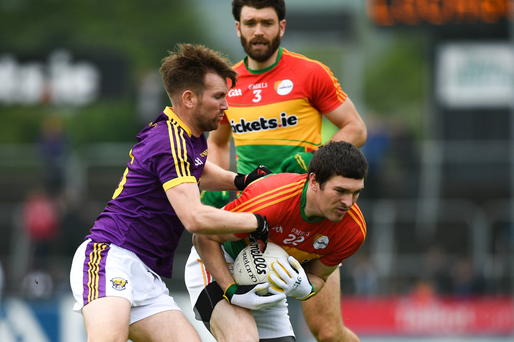 P.J. Banville tackling Conor Lawlor of Carlow on what proved to be his final Leinster Senior football championship game last May.