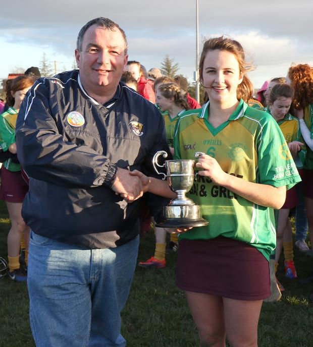 Kate Kirwan accepts the cup from Donnacha Kerins (Chairman).