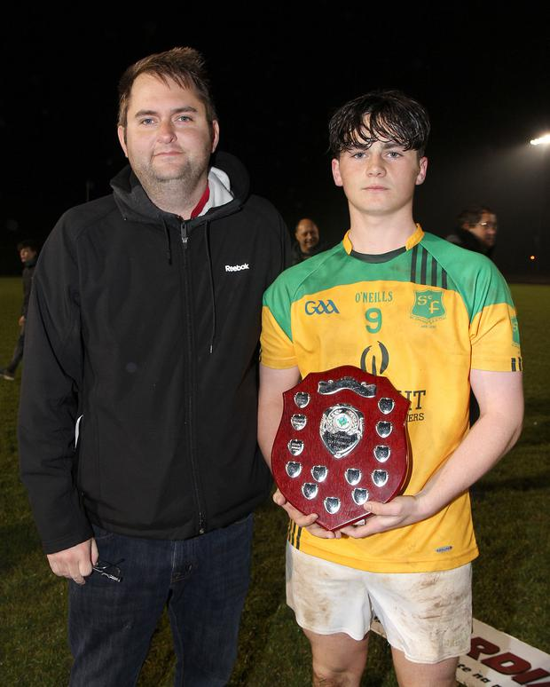 Winning captain James O'Leary with Dean Goodison.