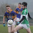 Connal Flood of Cloughbawn tries to negotiate a route past Barry Kelly and Enda Kelly of GOH
