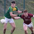 HWH Bunclody's Josh Martin battles for possession with Mikey Coleman of St. Martin's