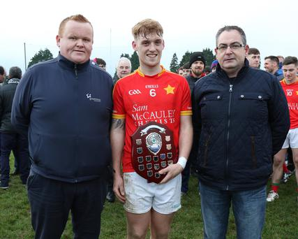 Team captain Dillon Redmond with Declan Kenny of Greenstar (sponsors) and P.J. Howlin (Co. P.R.O.)